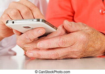 Browsing mobile internet - Picture of a senior woman hand...