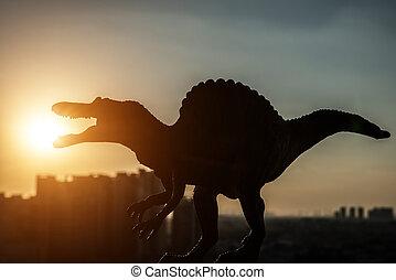 silueta, de, spinosaurus, y, edificios, en, ocaso, tiempo