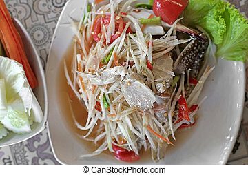 papaya salad or som-tam - famous Thai food, papaya salad or...