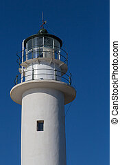 White tower of lighthouse and blue sky