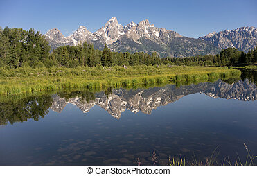 Rocky Mountain Range Reflected Smooth Water Grand Teton...