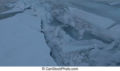Large blocks of ice crack.