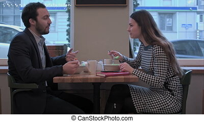 Business people enjoy lunch meal at restaurant - Young...