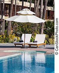 Luxury swimming pool and deck chair - Beautiful swimming...