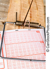 Compulsive lottery playing - Lottery ticket in a mousetrap,...