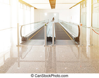 Moving walkway or escalator in exhibition hall building.