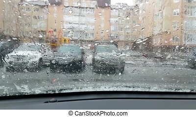 Hail falls on windshield of car parked in the yard. - Hail...