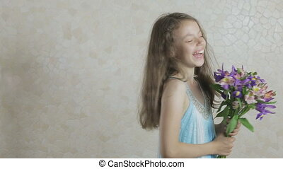 Beautiful girl with bouquet of flowers laughing - Beautiful...