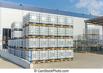 Packed pallets standing outdoors at a warehouse