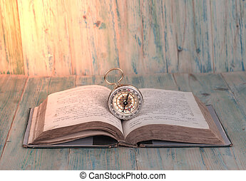 Old Compass on open old Text Book