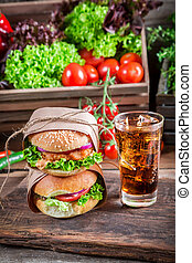 Takeaway homemade burger with cold drink