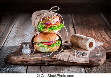Tasty takeaway burger wrapped in paper