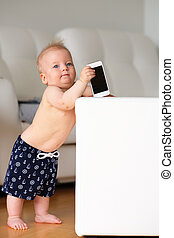 Baby boy playing with phone - Baby boy playing with mobile...