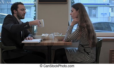 Business woman give reccomendations to collegue during...