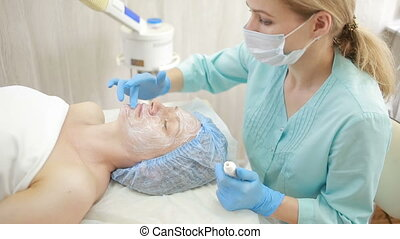 face of women getting a spa treatment. deep facial cleansing...
