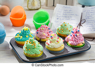 Preparation for sweet cupcakes with cream and decoration