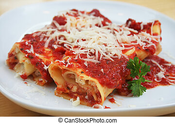 Manicotti - Two Manicotti on a White Plate