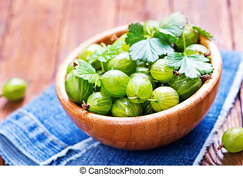 gooseberry - fresh gooseberry in bowl and on a table