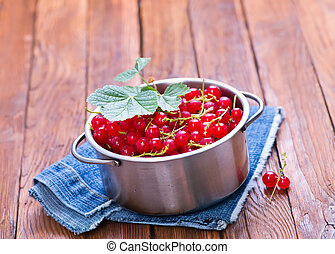 red currant in bowl and on a table