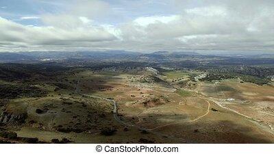 4K Aerial, flight over a plain field, Sierra De Las Nieves,...