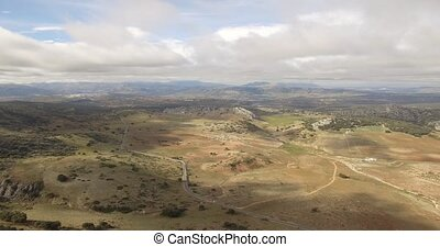 4K Aerial, flight over a plain field, Sierra De Las Nieves,...