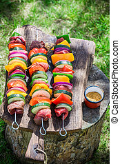 Fresh vegetables and meat with spices on grill