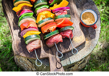 Fresh beef and vegetables with spices on grill