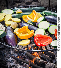 Fresh vegetables with spices on grill