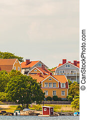 Ancient swedish houses in the seaside bay of Karlskrona -...
