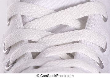 Shoe lace - Close up to a white sport style shoe