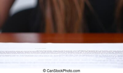 Girl puts a triangular print on the contract. Close up -...