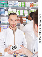 Pharmacist attending customer
