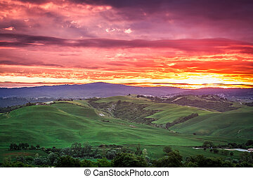 Beautiful view of green fields and meadows at sunset in...
