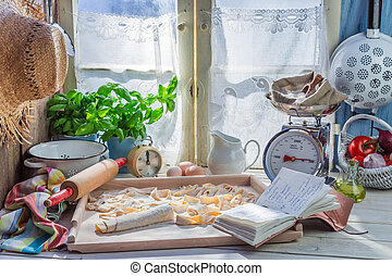 Preparations for pasta in the rustic kitchen