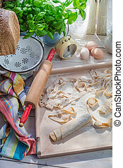 Preparations for pappardelle in the rustic kitchen