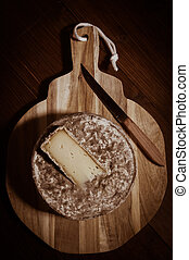 French tomme cheese for sale on a market stall, Studio shoot