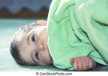 Serene baby on green floor