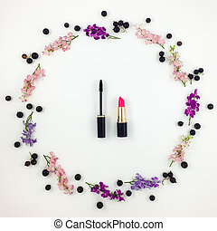 Decorative flat lay composition with cosmetics, flowers and...