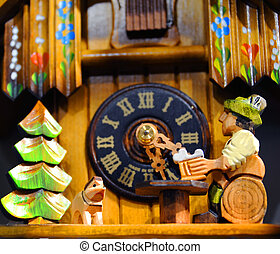 Beer Drinking Cuckoo - Cuckoo clock shows man sitting on a...