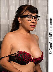 Brunette in red and black - Pretty mature brunette in red...