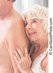 Feeling free together - Shot of a senior woman hugging her...