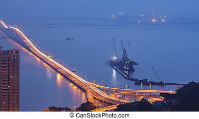 The Macau-Taipa bridge aerial view at night time