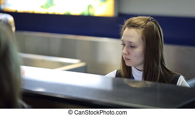 Sitting in airport young female is working with client...