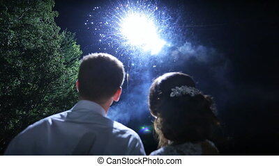 Newlyweds enjoy amazing view of sparkling fireworks on...