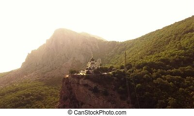 Church on the rock in the mountains. Aerial view from...
