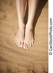 Woman feet with red toenails on sand - Woman feet with red...