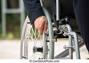 Person's Hand On Wheelchair