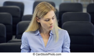 Beautiful young blond woman reluctantly or not respectful...