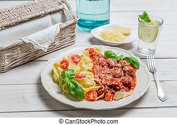 Spaghetti pasta, meatballs and cheese