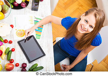 Nutritional education - A young adult woman informing...